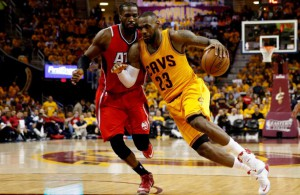 CLEVELAND, OH - MAY 26: LeBron James #23 of the Cleveland Cavaliers drives with the ball against DeMarre Carroll #5 of the Atlanta Hawks in the third quarter during Game Four of the Eastern Conference Finals of the 2015 NBA Playoffs at Quicken Loans Arena on May 26, 2015 in Cleveland, Ohio. NOTE TO USER: User expressly acknowledges and agrees that, by downloading and or using this Photograph, user is consenting to the terms and conditions of the Getty Images License Agreement. (Photo by Gregory Shamus/Getty Images)